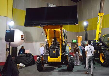backhoe loader: big motor sale BANGKOK, THAILAND- August 22,2014  backhoe loader at Bi-Tech convention center Editorial