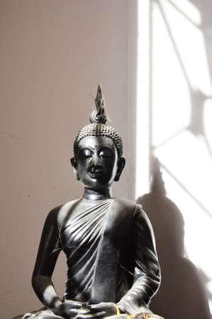 representations: image of Buddha on shadow Stock Photo