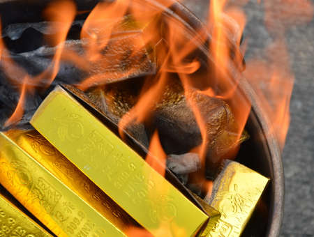 the next life: gold paper burning Editorial