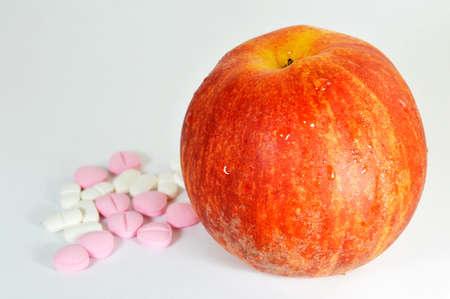 decease: medicine and apple Stock Photo