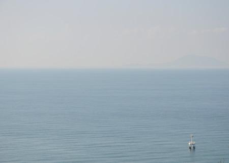 vast: buoy floating on the vast sea