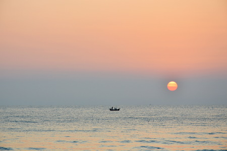 fishery boat on sunrise in the sea Stock Photo