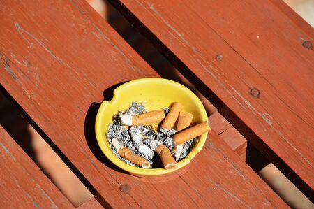 ashtray: ashtray on wood board