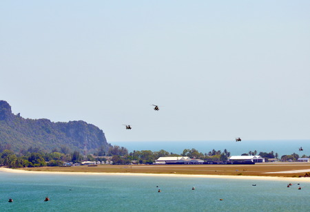 military helicopter: military helicopter fly to the camp at the beach