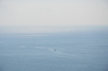 fishery: fishery boat floating on the vast sea