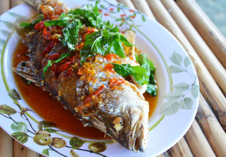 chilli sauce: fried bass fish dressing with chilli sauce