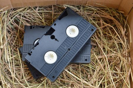 video recorder cassette on straw in the box photo