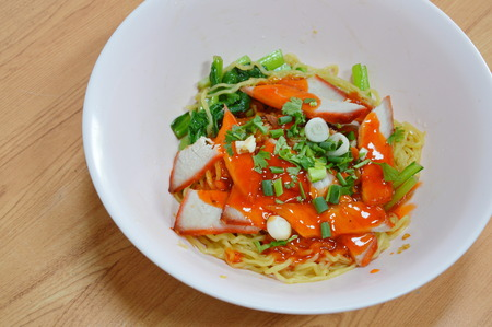 chinese noodle: Chinese noodle topping slice barbeque pork and dressing sweet red sauce