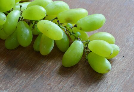 digest: grape fruit on the wood table