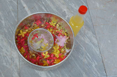scent: water flower in the bowl and scent bottle Stock Photo