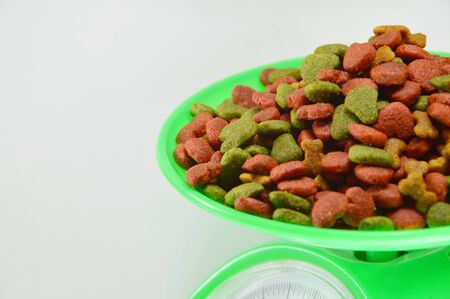 weighting: pet food on weighting scale Stock Photo