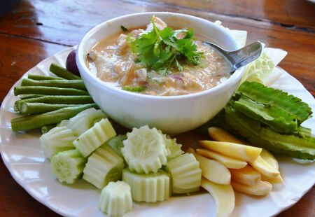 coconut crab: herb soya bean with crab and pork in coconut milk served with fresh vegetables
