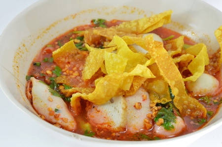 fish ball: noodles with fish ball and red sauce in spicy soup