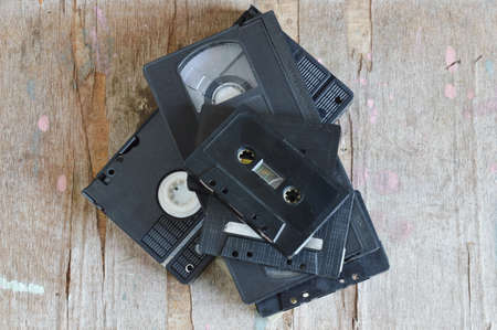 video cassette tape: cassette tape and video tape recorder on wood board