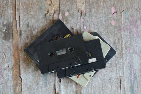 baby boomer: cassette tape recorder on wood background