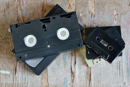superannuated: cassette tape and video tape recorder on wood board