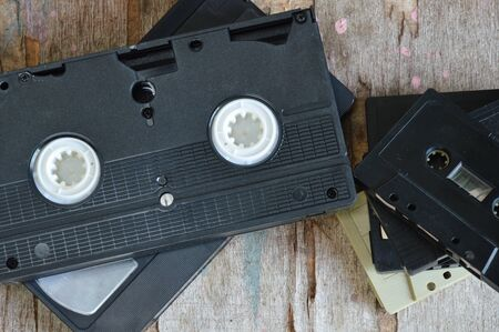 superannuated: video tape and cassette tape on wood board