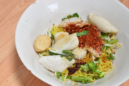 fish ball: egg noodle with kind of fish ball and topping paprika Stock Photo