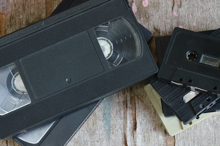 video cassette tape: video tape and cassette tape on wood board
