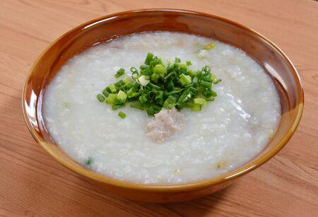 rice porridge topping slice spring onion