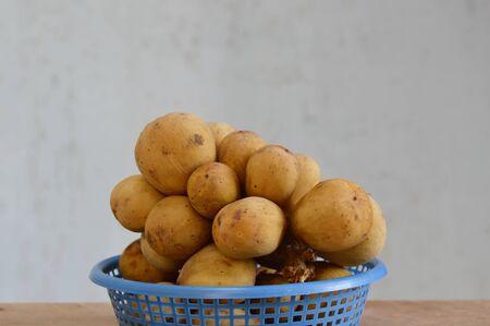local supply: Langsat Asian fruit on basket