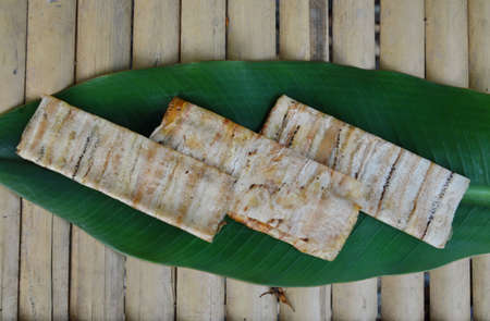 fruit trade: grilled flat banana Cambodian food on banana leaf