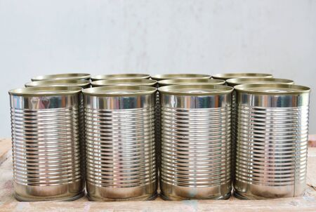 tin can: tin can food on wooden board