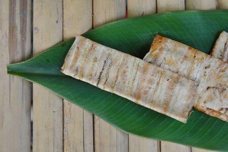 cambodian: grilled flat banana Cambodian food on banana leaf