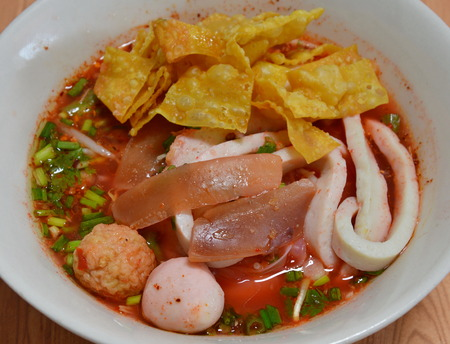 fish ball: noodles with fish ball and red sauce in soup