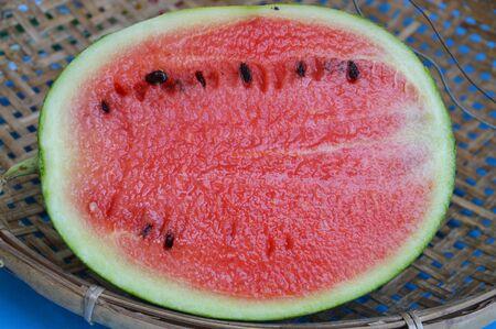 threshing: watermelon on bamboo threshing basket Stock Photo