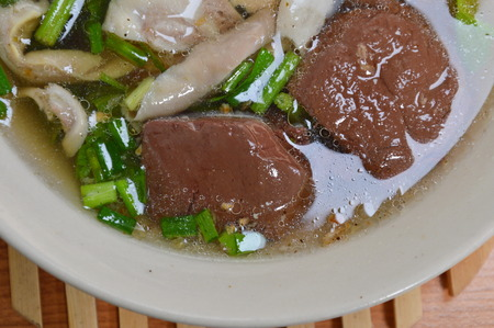 entrails: boiled pork blood with entrails in soup Stock Photo
