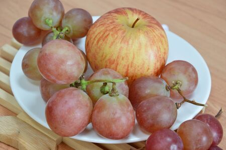 red grape: apple and red grape Stock Photo