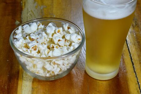 popcorn bowls: popcorn in bowl and beer Stock Photo