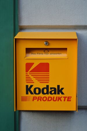 mail box: Interlaken Switzerland June 2, 2014 Kodak mail box in front of photo shop in Interlaken Switzerland Editorial