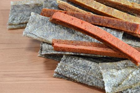 dog salmon: dog snack crispy salmon skin and chicken soft stick Stock Photo