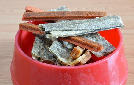 dog salmon: dog food crispy salmon skin and chicken soft stick on bowl