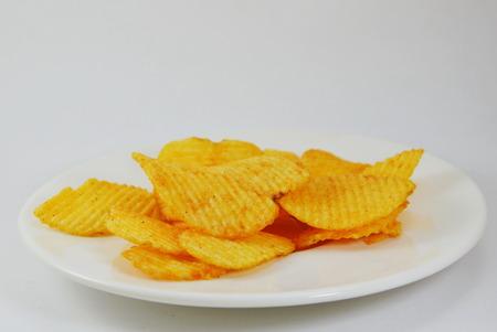 potato chip: potato chip on dish