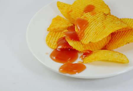 potato chip: potato chip dressing ketchup on dish Stock Photo