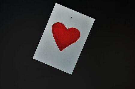 job deadline: red heart paper note on computer screen