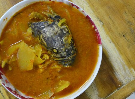common snakehead: spicy sour soup with  striped snake-head fish and papaya