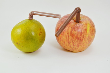 stab: straw stab in red apple and orange