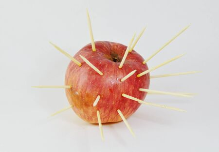 stab: toothpicks stab into red apple Stock Photo