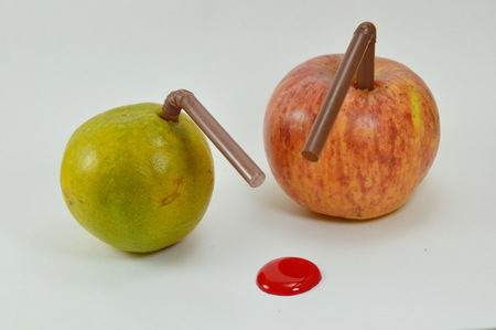 stab: orange and apple stab by straw with liquid red dot drop