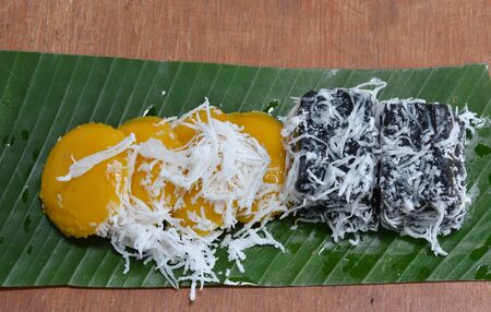 cake topping: toddy palm cake topping slice coconut on banana leaf