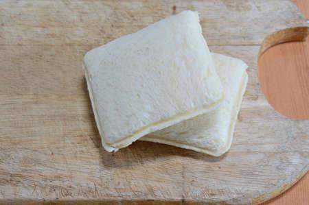 chop: sandwich on wooden chop plate