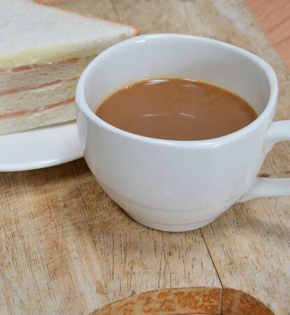 bologna: milk coffee and bologna sandwich