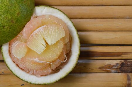 pomelo: pomelo Thai fruit on bamboo Stock Photo