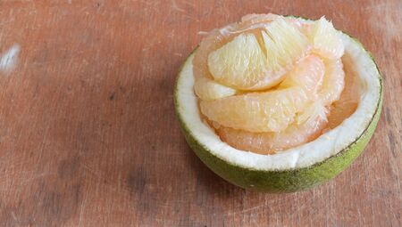 fruit trade: grapefruit on wooden table Stock Photo