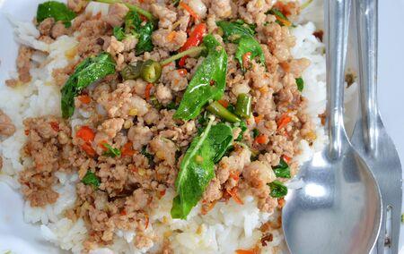 thai style: spicy stir-fried pork chop with basil leaf and chili