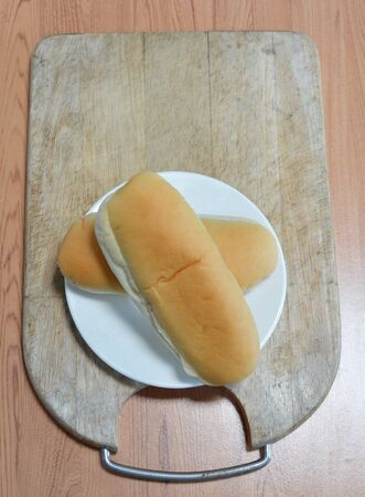 chop: bread on wooden chop plate